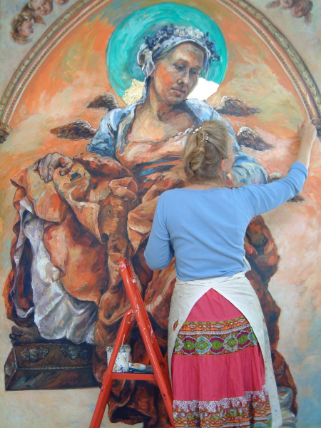 A large painting shown in progress in the studio of healing Archangel Raphael.